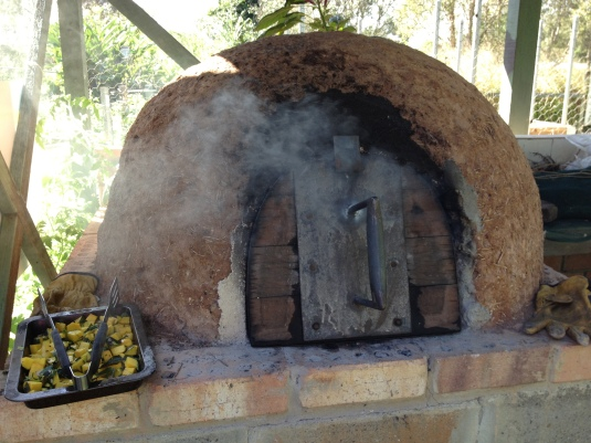 The cob oven smoking and ready to go